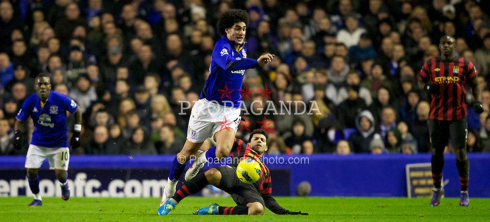 LIVERPOOL, ENGLAND - Tuesday, January 31, 2012: Manchester City's Sergio Aguero in action against Everton's Marouane Fellaini during the Premiership match at Goodison Park. (Pic by Vegard Grott/Propaganda)
