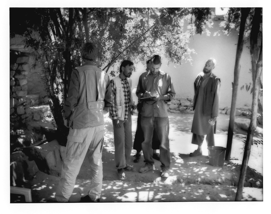 Andre, an Australian engineer and second from right, charts a diagram for a new arbour for Turquoise Mountain's Istalif headquarters while local staff look on.  Turquoise Mountain Foundation, a non-profit organization, is helping to preserve Istalif's traditional ceramics industry and encourage tourism to the mountain village about one hour north of Kabul.