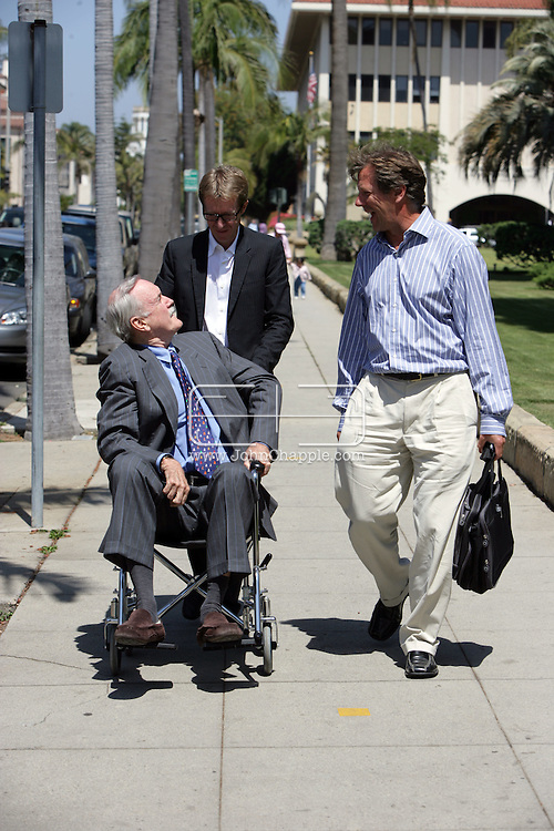 EXCLUSIVE..13th May 2008, Santa Barbara, California. Actor John Cleese arrives at Santa Barbara court house for his divorse hearing. The aging British, Monty Python star arrived in a wheelchair and showed off his scars from a recent knee operation. John is pictured with his assistant Garry Scott-Irvine and Daily Mail reporter David Gardner. PHOTO © JOHN CHAPPLE / REBEL IMAGES.john@chapple.biz     www.chapple.biz