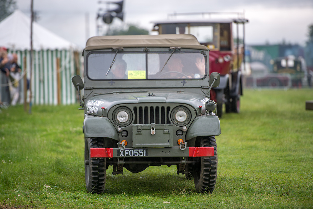 Front view of classic Jeep riding along in the grass, Masham, North Yorkshire, UK