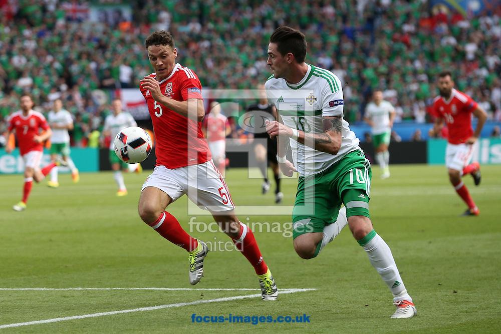 Kyle Lafferty of Northern Ireland and James Chester of Wales in action during the UEFA Euro 2016 match at Parc des Princes, Paris<br /> Picture by Paul Chesterton/Focus Images Ltd +44 7904 640267<br /> 25/06/2016