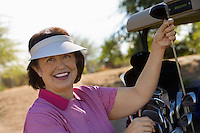 Woman Selecting Golf Club