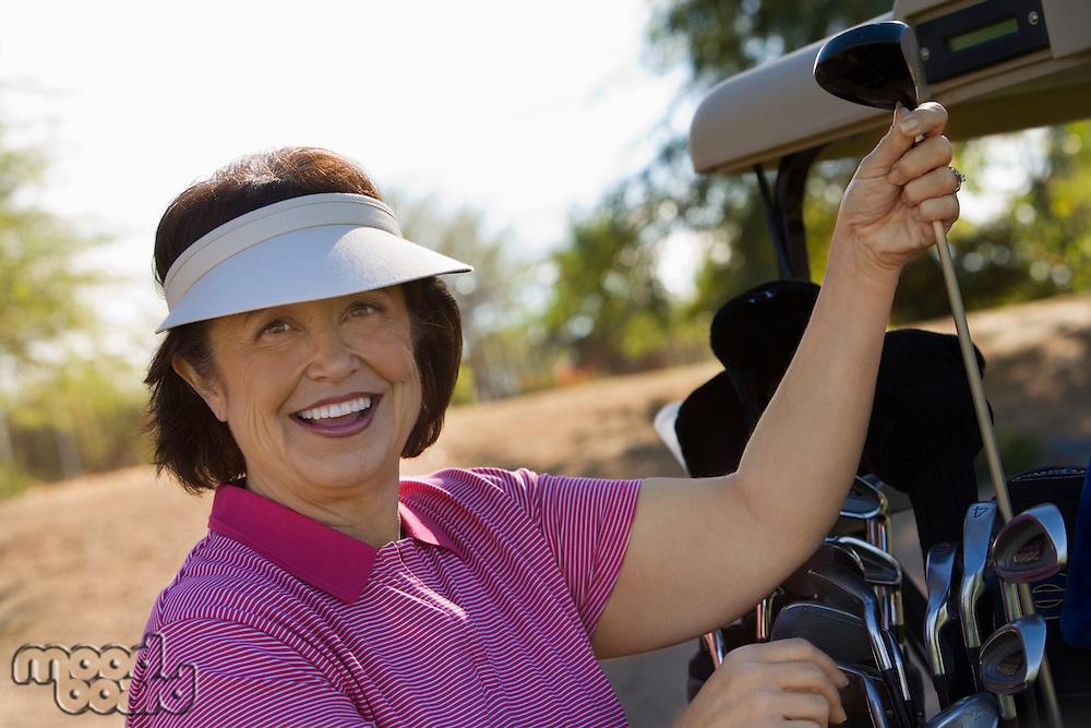 Woman Selecting Golf Club