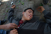 A protester lay down affected by teargas after a clash with the police.Tunisians from province camp under the the Prime Minister's office demanding the dissolution of the interim governement.