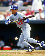 LAKELAND - 1995:  Brett Butler of the Los Angeles Dodgers bunts during an MLB spring training game in Lakeland Florida.  Butler played for the Dodgers from 1991-1994 and 1995-1997.  (Photo by Ron Vesely)