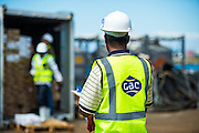 GAC Employee overseeing unloading of container