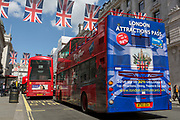 The rear of a London tour bus featuring an illustration of tourist attractions, with an iVenture card saves visitors up to 50% on tickets at the capital's landmarks, on 1st May, in Piccadilly Circus, London, England.