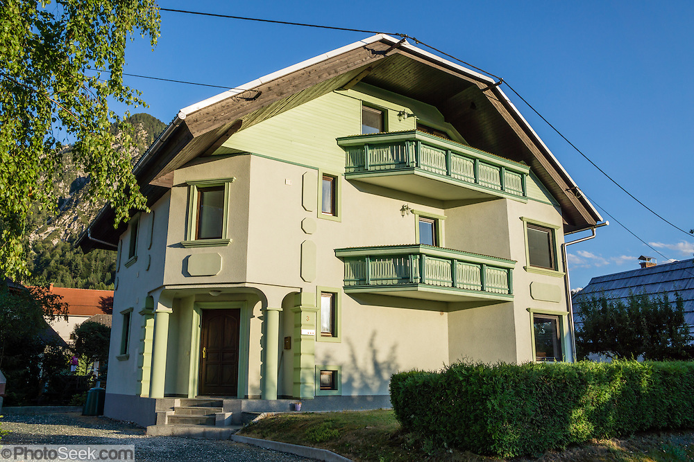Lime green house, in Mojstrana, Slovenia, Europe. In 1991, Slovenia declared full sovereignty from Yugoslavia. 80% of its 2 million people speak Slovene. In 2004, Slovenia joined NATO and the EU (European Union), and later adopted the Euro € currency. Slovenia is the richest Slavic nation per capita.