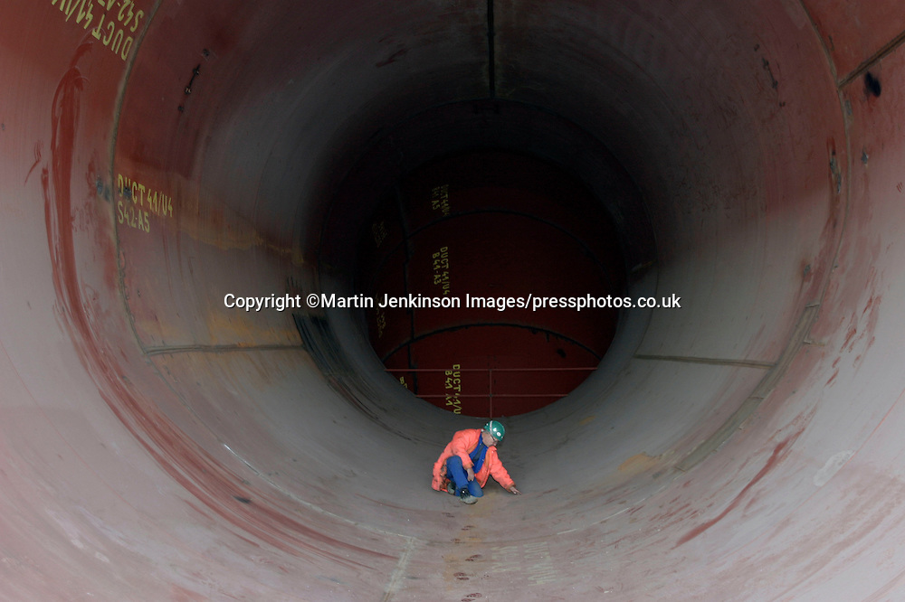 Engineer checking the inside of ducting for the Installation of flue gas desulpherisation at Eggborough coal fired power station.