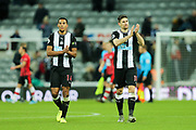Match winning goal scorer Federico Fernandez (#18) of Newcastle United and Isaac Hayden (#14) of Newcastle United applaud the Newcastle United supporters followig the Premier League match between Newcastle United and Southampton at St. James's Park, Newcastle, England on 8 December 2019.