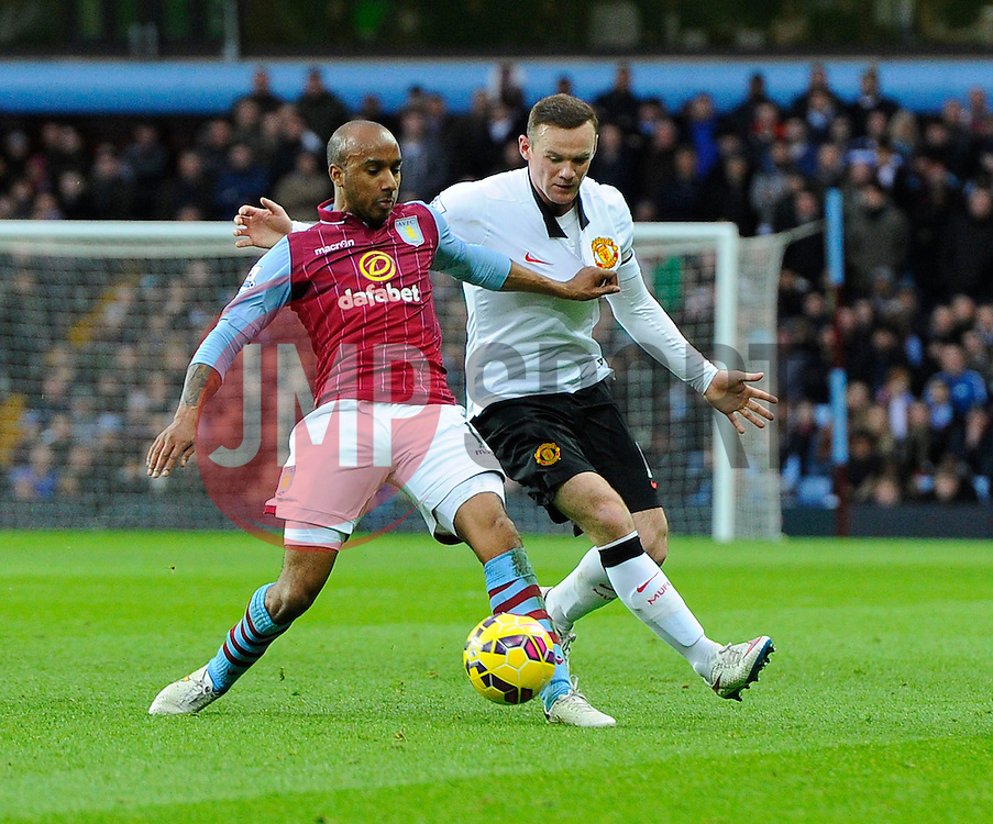 Aston Villa's Ciaran Clark battles for the ball with Manchester United's Wayne Rooney  - Photo mandatory by-line: Joe Meredith/JMP - Mobile: 07966 386802 - 20/12/2014 - SPORT - football - Birmingham - Villa Park - Aston Villa v Manchester United - Barclays Premier League