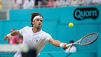 Tennis - 2019 Queen's Club Fever-Tree Championships - Day Seven, Sunday<br /> <br /> Men's Singles Final: Feliciano Lopez (ESP) Vs. Gilles Simon (FRA)<br /> <br /> <br /> Feliciano Lopez (ESP) stretches to make the return on Centre Court.<br />  <br /> COLORSPORT/DANIEL BEARHAM