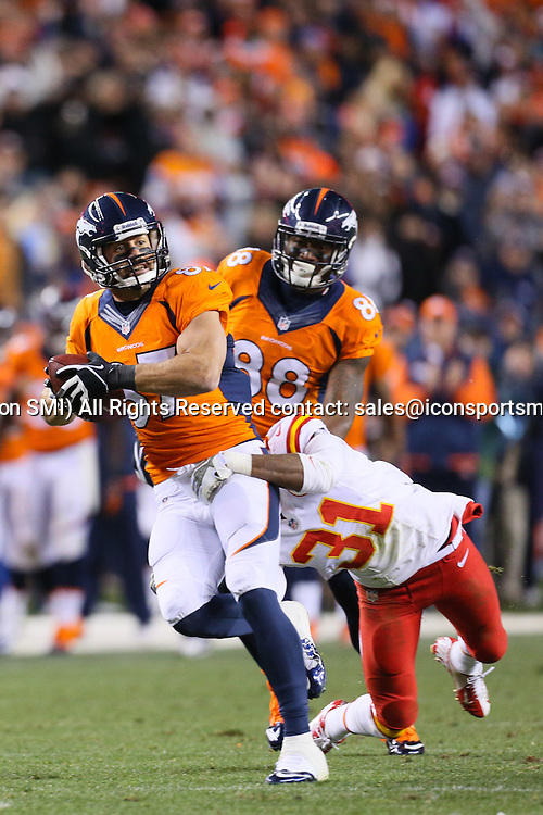 17 November 2013: Denver Broncos wide receiver Eric Decker (87) runs with the ball during a game between the Denver Broncos and the Kansas City Chiefs at Sports Authority Field at Mile High, Denver, CO.
