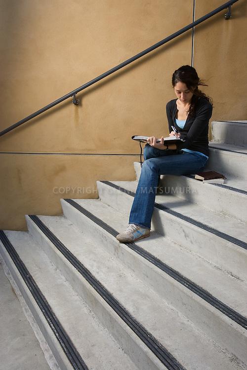 Stanford student, RaenaSaddler (Evangelical Christian) on steps of Cantor Museum.