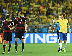 08.07.2014, Mineirao, Belo Horizonte, BRA, FIFA WM, Brasilien vs Deutschland, Halbfinale, im Bild Brazil's David Luiz (R) points at Germany's Thomas Muller (L) // during Semi Final match between Brasil and Germany of the FIFA Worldcup Brazil 2014 at the Mineirao in Belo Horizonte, Brazil on 2014/07/08. EXPA Pictures © 2014, PhotoCredit: EXPA/ Photoshot/ Liu Dawei<br /> <br /> *****ATTENTION - for AUT, SLO, CRO, SRB, BIH, MAZ only*****