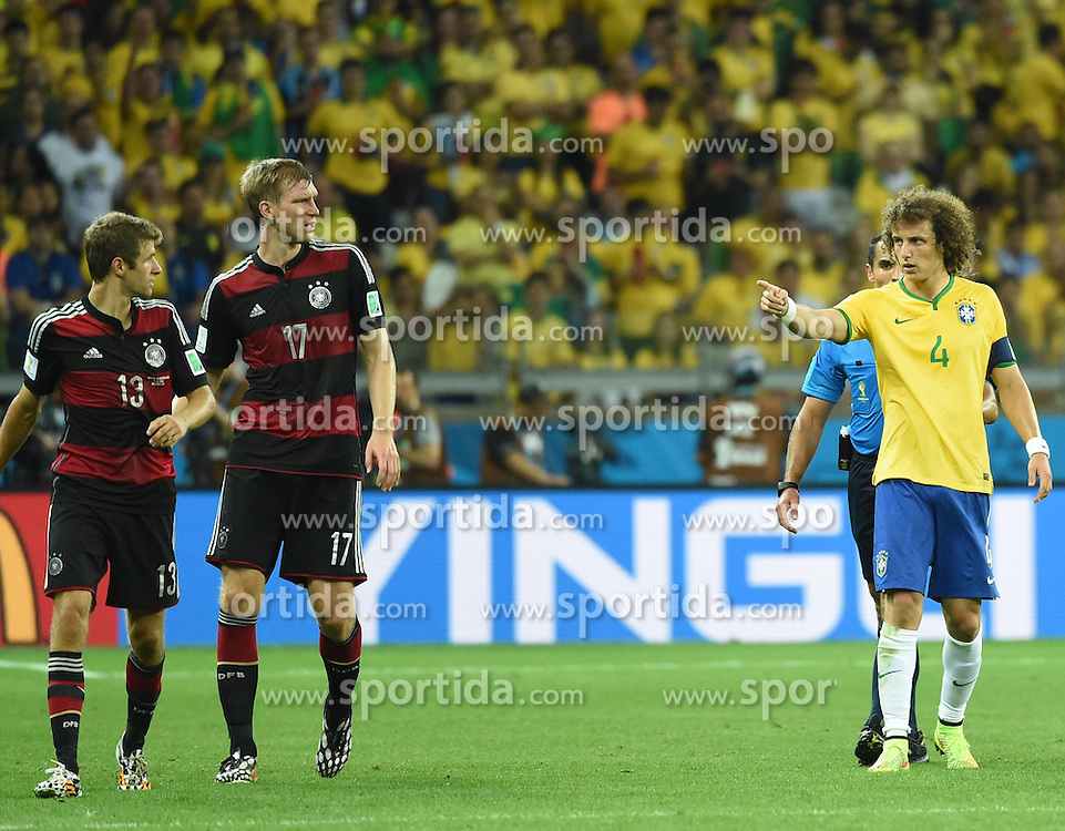 08.07.2014, Mineirao, Belo Horizonte, BRA, FIFA WM, Brasilien vs Deutschland, Halbfinale, im Bild Brazil's David Luiz (R) points at Germany's Thomas Muller (L) // during Semi Final match between Brasil and Germany of the FIFA Worldcup Brazil 2014 at the Mineirao in Belo Horizonte, Brazil on 2014/07/08. EXPA Pictures &copy; 2014, PhotoCredit: EXPA/ Photoshot/ Liu Dawei<br /> <br /> *****ATTENTION - for AUT, SLO, CRO, SRB, BIH, MAZ only*****