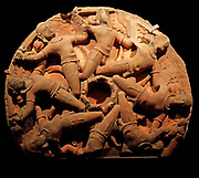 SANDSTONE CARVED CEILING BOSS DEPICTING A CIRCLE OF FLYING WARRIORS. FROM RAJASTAN, INDIA. CIRCA 750-850ad. tHE SOLDIERS MAY REPRESENT aDHARAS OR BEARERS OF KNOWLEDGE.