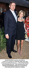 HANS RAUSING and his wife EWA at a dinner in London on 24th May 2004.PUJ 138