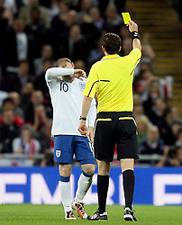 12.10.2010, Wembley Stadium, London, ENG, UEFA 2012 Qualifier, England vs Montenegro, im Bild Wayne Rooney of England tackles from Behind  Elsad Zverotic of Montenegro   and earns a yellow card, EXPA Pictures © 2010, PhotoCredit: EXPA/ IPS/ Marcello Pozzetti *** ATTENTION *** UK AND FRANCE OUT!