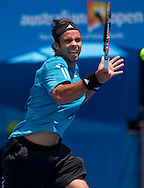 Fernando Gonzalez (CHI) [11]<br /> 2010 Australian Open Tennis<br /> Mens Singles<br /> First Round<br /> 18/01/10<br /> Fernando Gonzalez of Chillie hits his monstorous forhand during his first round match against Olivier Rochus of Belgium<br /> &quot;Show Court 2&quot; Melbourne Park, Melbourne, Victoria, Australia<br /> Photo By Lucas Wroe