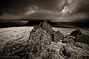 An ominous looking Mynydd Mawr in low cloud and bad weather as seen from the craggy summit of Moel Tryfan above Rhostryfan, Snowdonia, Gwynedd, Wales