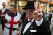 Winston Churchill impersonator, Derek Herbert gives his Battle of Britain speech in front of three knights and lunchtime drinkers on St George's Day in Leadenhall Market in the capital's financial district (aka The Square Mile), on 23rd April, City of London, England.