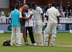 August 12, 2018 - London, Greater London, United Kingdom - Physio looking at Ravichandran Ashwin of India having problem with his finger during International Test Series 2nd Test 4th day  match between England and India at Lords Cricket Ground, London, England on 12 August  2018. (Credit Image: © Action Foto Sport/NurPhoto via ZUMA Press)