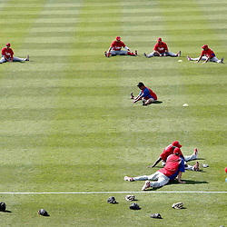 March 20, 2012; Sarasota, FL, USA;Philadelphia Phillies players stretch before a spring training game against the Baltimore Orioles at Ed Smith Stadium.  Mandatory Credit: Derick E. Hingle-US PRESSWIRE