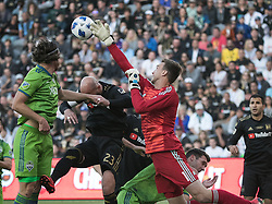 April 29, 2018 - Los Angeles, California, U.S - Tyler Miller #1, goalie of the LAFC punches a ball during their MLS game against the Seattle Sounders on Sunday April 29, 2018, their first game at the Banc of California Stadium in Los Angeles, California. LAFC defeats Sounders, 1-0. (Credit Image: © Prensa Internacional via ZUMA Wire)