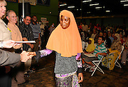 Refugees from around the globe celebrate at Tucson World Refugee Fest 2012, where some received their  citizenship papers in Tucson, Arizona, USA.