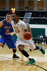 Nov 16, 2011; San Francisco CA, USA;  San Francisco Dons guard Rashad Green (13) dribbles past San Jose State Spartans forward Wil Carter (15) during the first half at War Memorial Gym.  Mandatory Credit: Jason O. Watson-US PRESSWIRE