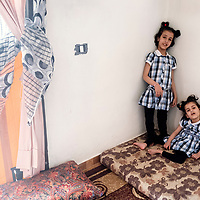 Fatima (left) and Isra (right) are two Syrian refugees who are living with their elderly ill grandmother in Lebanon. Their father was kidnapped in Syria and their mother decided to leave them and live on her own. <br /> <br /> Both of them suffer from IMC. Now Fatime is able to sit properly and interact with her relatives instead of lying on the bed and staring at the ceiling all day.<br /> On the other hand, Isra'a who could barely walk and talk started directly responding well with the physiotherapist who helped her gain balance while walking which made it easier for her to deal with her daily habits.
