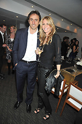 MELISSA ODABASH and her husband NICOLAS DE SANTIS at a dinner hosted by Ruinart Champagne for Yasmin Mills at Nobu, Park Lane, London on rth May 2009.