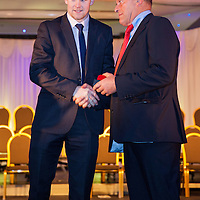 Tony Kelly (Capt) from Ballyea receiving his U21 Hurling medal from Former Senior manager, Ger Loughnane