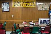 Reminders of Stephenville High Schools five state championships decorate the walls at Jack & Dorothy's Cafe in Stephenville, Texas on November 5, 2013. Current Baylor head coach Art Briles won the first four state championships for Stephenville in the 1990's with current Stephenville coach Joseph Gillespie winning the first since the Briles era last season. (Cooper Neill / for The New York Times)