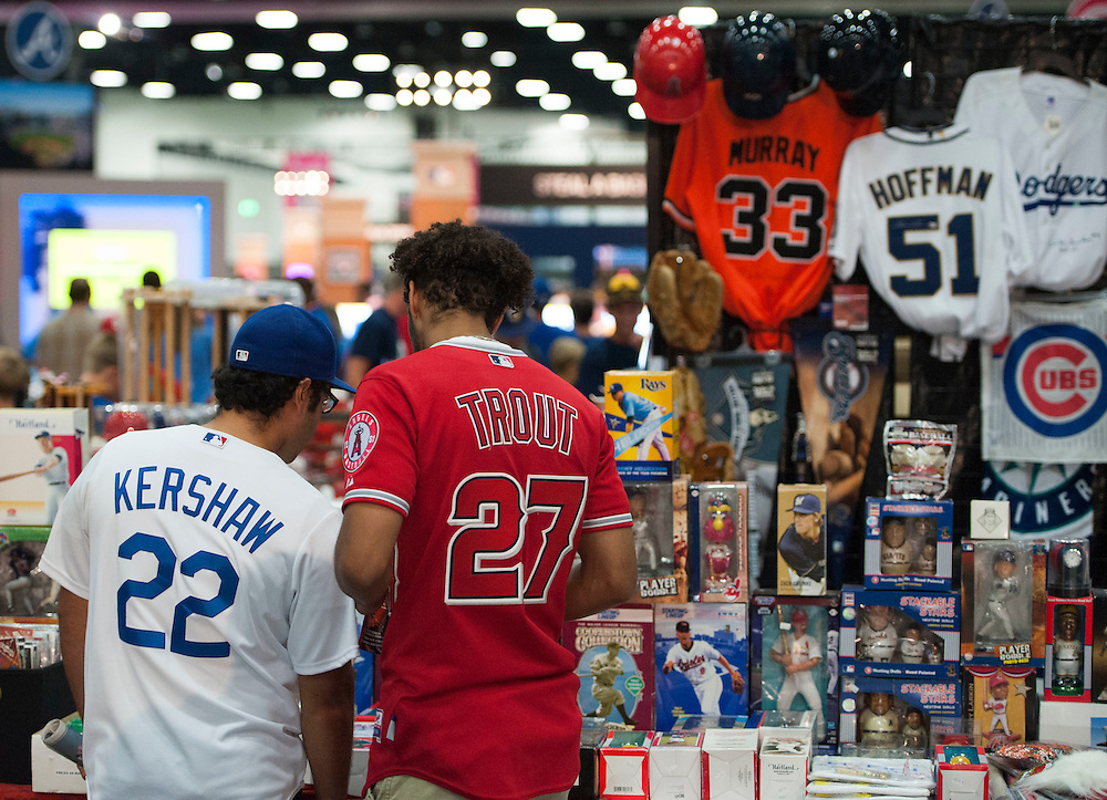 Luis Lebron, 22, at left, and Juwun McCray, 22, both of San Diego, check out collectibles during the 2016 MLB All-Star FanFest at the San Diego Convention Center on Friday.<br /> <br /> ///ADDITIONAL INFO:   <br /> <br /> Fanfest.0709.kjs  ---  Photo by KEVIN SULLIVAN / Orange County Register  -- 7/8/16<br /> <br /> The 2016 MLB All-Star game Fan Fest at Petco Park and the San Diego Convention Center.