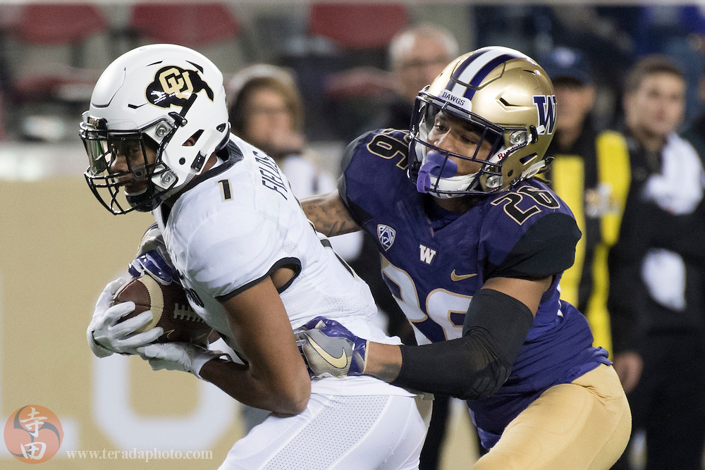 December 2, 2016; Santa Clara, CA, USA; Colorado Buffaloes wide receiver Shay Fields (1) is tackled by Washington Huskies defensive back Sidney Jones (26) during the first quarter in the Pac-12 championship at Levi's Stadium.