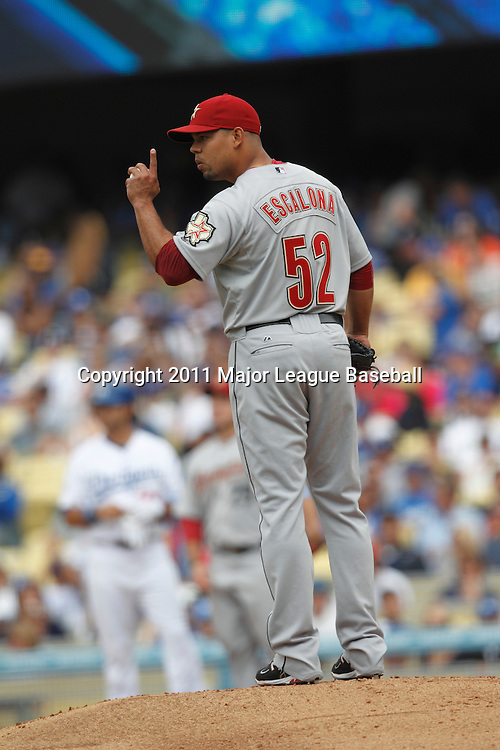 LOS ANGELES - JUNE 19:  Relief pitcher Sergio Escalona #52 of the Houston Astros motions toward the infield during the game against the Los Angeles Dodgers at Dodger Stadium on Sunday, June 19, 2011 in Los Angeles, California.  The Dodgers defeated the Astros 1-0.  (Photo by Paul Spinelli/MLB Photos via Getty Images) *** Local Caption *** Sergio Escalona