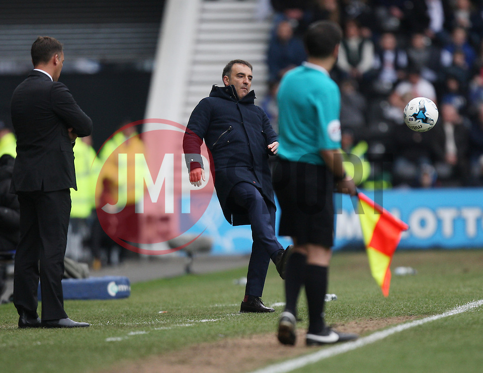 Sheffield Wednesday Manager Carlos Carvalhal (C) kicks the ball back into play - Mandatory by-line: Jack Phillips/JMP - 23/04/2016 - FOOTBALL - iPro Stadium - Derby, England - Derby County v Sheffield Wednesday - Sky Bet Championship