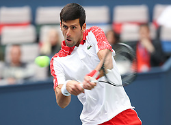 SHANGHAI, Oct. 12, 2018  Serbia's Novak Djokovic hits a return during the men's singles quarterfinal match against Kevin Anderson of South Africa at the Shanghai Masters tennis tournament on Oct. 12, 2018. Novak Djokovic won 2-0. (Credit Image: © Ding Ting/Xinhua via ZUMA Wire)