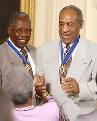 Bill Cosby admires his Presidential Medal of Freedom that he received from United States President George W. Bush during a ceremony in the East Room of the White House in Washington, D.C. on July 9, 2002..Credit: Ron Sachs / CNP. 09 Jul 2002 Pictured: Hank Aaron and Bill Cosby accept congratulations after they received the Presidential Medal of Freedom from United States President George W. Bush during a ceremony in the East Room of the White House in Washington, D.C. on July 9, 2002..Credit: Ron Sachs / CNP. Photo credit: Ron Sachs / CNP / MEGA TheMegaAgency.com +1 888 505 6342