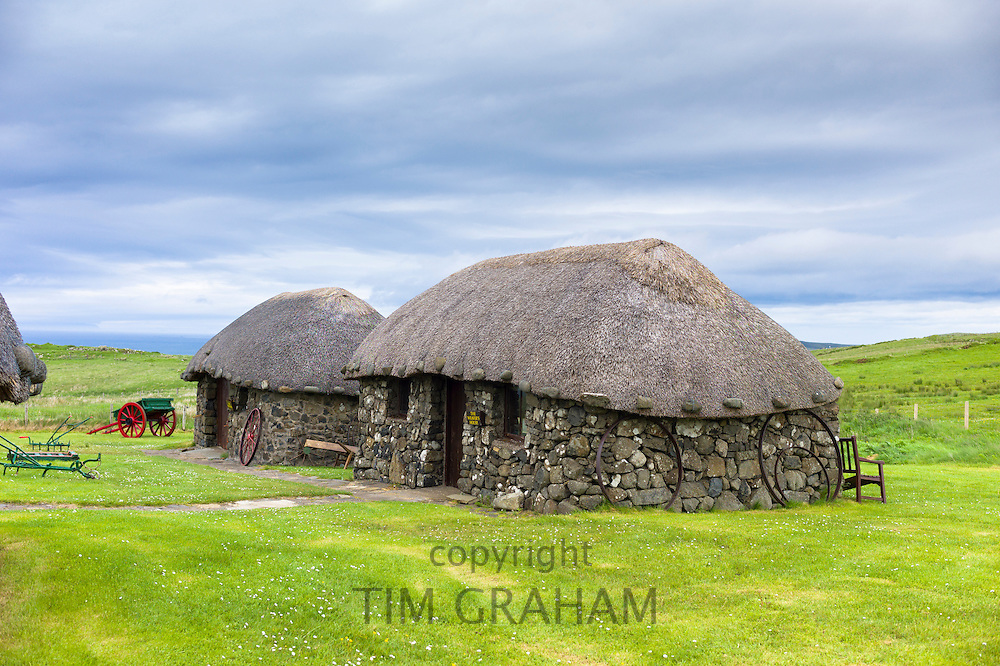 Tourist attraction Skye Museum of Village Life depicts thatched stone cottages and barns with farm implements in ancient crofting housing at Kilmuir, Isle of Skye, the Western Isles of Scotland, UK
