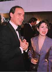 MR JAMES GILBEY friend of the late Diana, Princess of Wales and MISS SHARON SILVER, at a reception in London on 6th June 1998.MIB 127