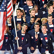 United States of America swimmer Michael Phelps carried the American flag during the Opening Ceremonies of the 2016 Summer Olympics Games in Rio de Janeiro, Brazil.