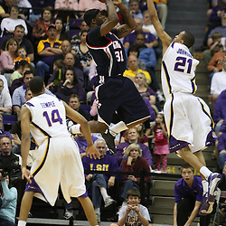 14 February 2009: Murphy Holloway (31) of Ole Miss shoots over LSU center Chris Johnson (21) during a 73-66 win by the LSU Tigers against SEC rival the Ole Miss Rebels at the Pete Maravich Assembly Center in Baton Rouge, LA.