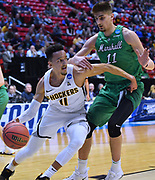 SAN DIEGO, CA - MARCH 16:  Landry Shamet #11 of the Wichita State Shockers drives against Ajdin Penava #11 of the Marshall Thundering Herd during a first round game of the Men's NCAA Basketball Tournament at Viejas Arena in San Diego, California. Marshall won 81-75.  (Photo by Sam Wasson)
