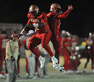 Lafayette High's Jeremy Liggins (1) celebrates a touchdown with Lafayette High's Demarkous Dennis (5) vs. Greenwood High in MHSAA playoff action in Oxford, Miss. on Friday, November 11, 2011. Lafayette High won 53-8.
