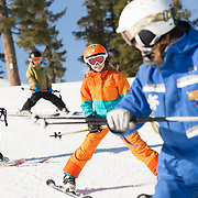 Sage and Dane Gaffney, and Libby Webb, at ski school with instructor Katie Mansfield at Northstar Mountain Resort.