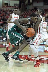 20 November 2013:  CJ Jones heads for the basket blocked by Bobby Hunter, Bobby Hunter gets called for a foul during an NCAA Non-Conference mens basketball game between the Jaspers of Manhattan and the Illinois State Redbirds in Redbird Arena, Normal IL