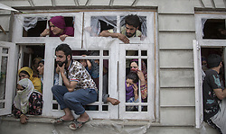 June 17, 2017 - Khudwani, Kashmir, India - Kashmiri villagers watch the funeral procession of local rebel commander Junaid Matoo Saturday, June 17, 2017, in Khudwani village about 60 kilometers (37 miles) south of Srinagar, Indian-administered Kashmir. Three militants were killed Saturday in a gun battle with government forces in the disputed region. Two civilians were killed and dozens of others injured in clashes that erupted near the gunfight site, officials said. (Credit Image: © Ahmer Khan/NurPhoto via ZUMA Press)